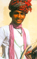 http://www.webindia123.com/Rajasthan/images/tradtional%20dress-male.jpg