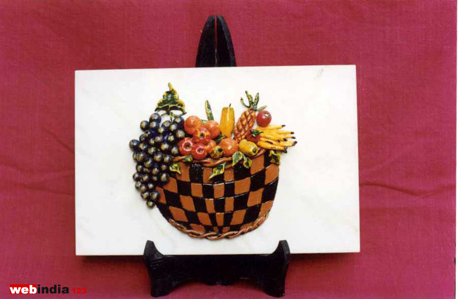 fruit basket on a wooden stand