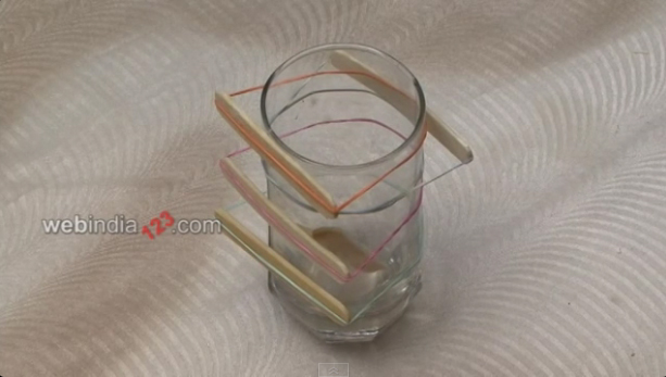 use a rubber band and strap it to a glass