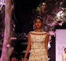 A+model+displays+the+creation+of+fashion+designer+Manish+Malhotra+during+the+Lakme+Fashion+Week+%28LFW%29+Summer%2F+Resort+2014+in+Mumbai%2C+India+on+March+11%2C+2014