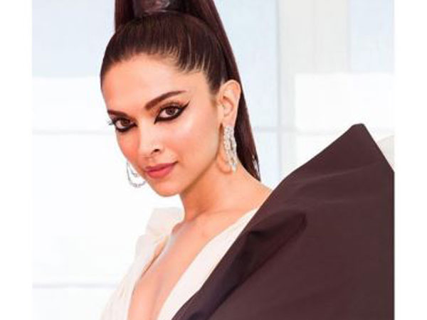 Gift wrapped in exaggerated bow, Deepika Padukone walks Cannes Red Carpet